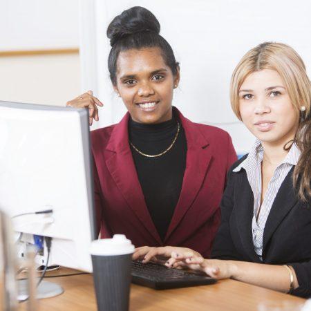 Two Australian Aboriginal women working in an office